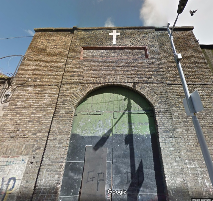 White tile cross over a gateway on the back of the former Magdalen Laundry on Railway St (Google, 2014)